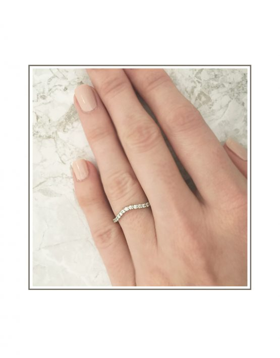 Curved White Gold Wedding Band Styled on Hand