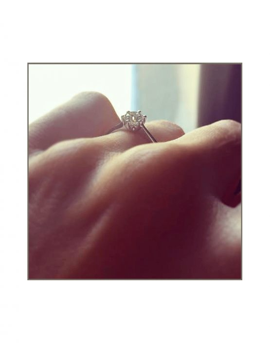 0.50ct-solitaire-protia-set-with-wedding-band-on-hand